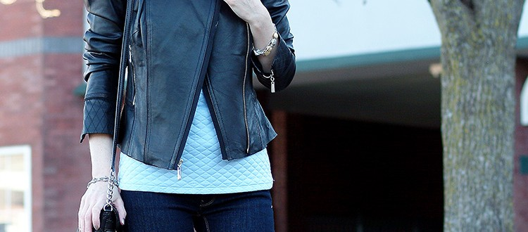 Ann Robie Fashion, blogger style: blue quilted sleeveless top, jeans, black leather jacket, sky blue earrings